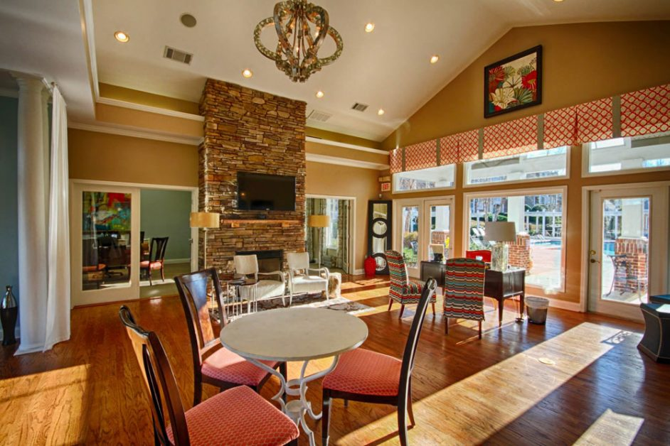 Apartment club house with fire place and patio with pool - The Legends Apartments