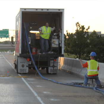 Liftech technicians repairing concrete on a highway