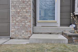 Concrete porch in need of repair
