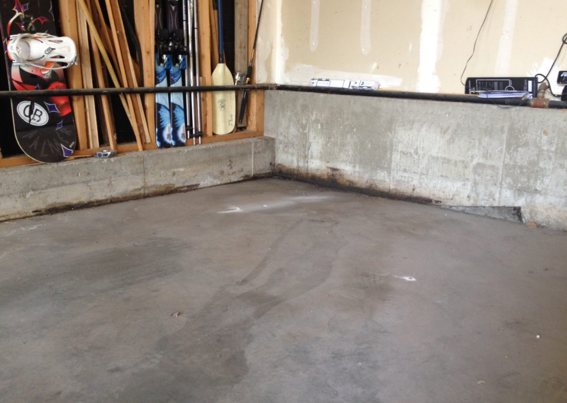 Concrete garage floor in need of repair