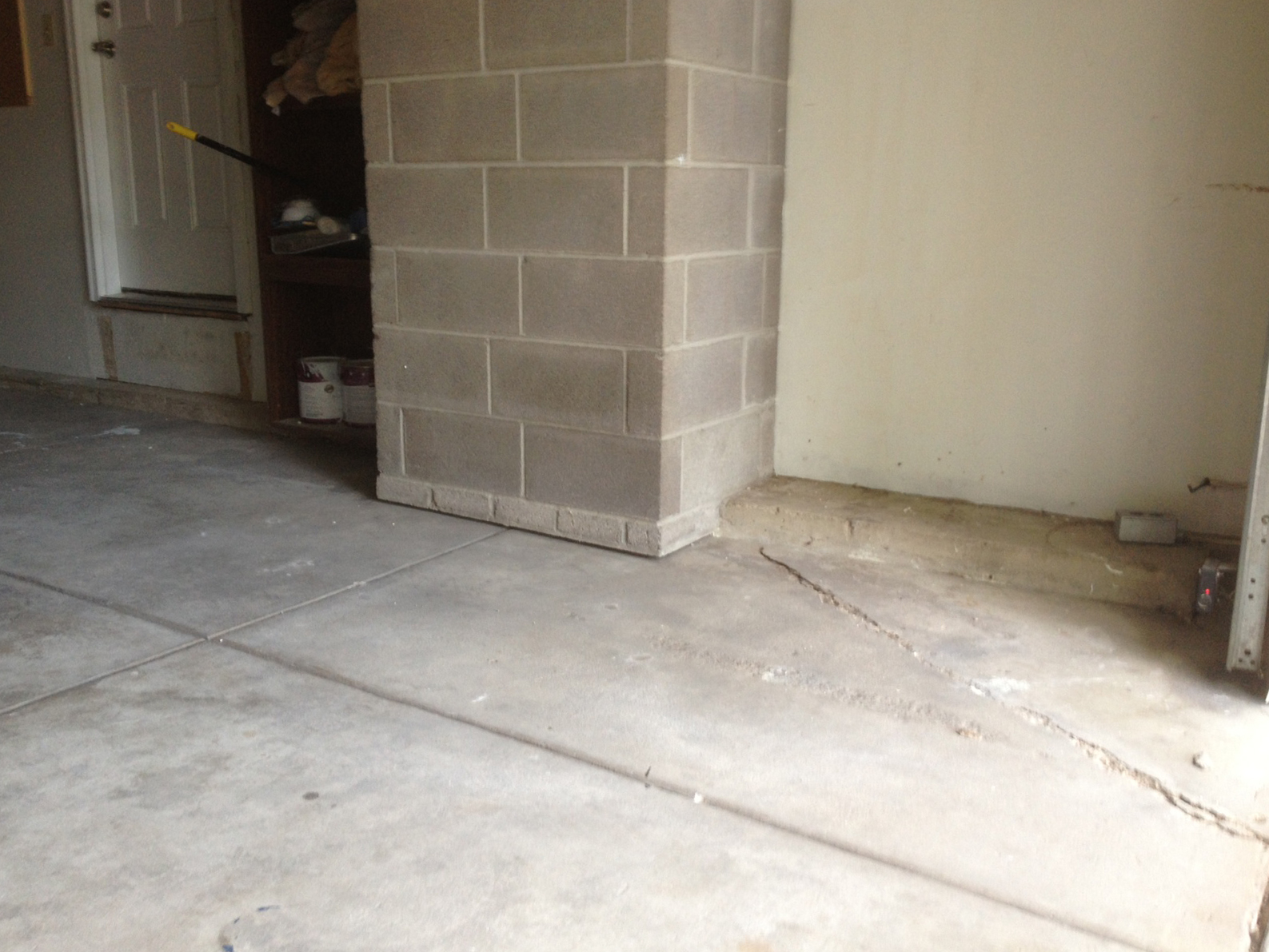Concrete garage floor after being lifted