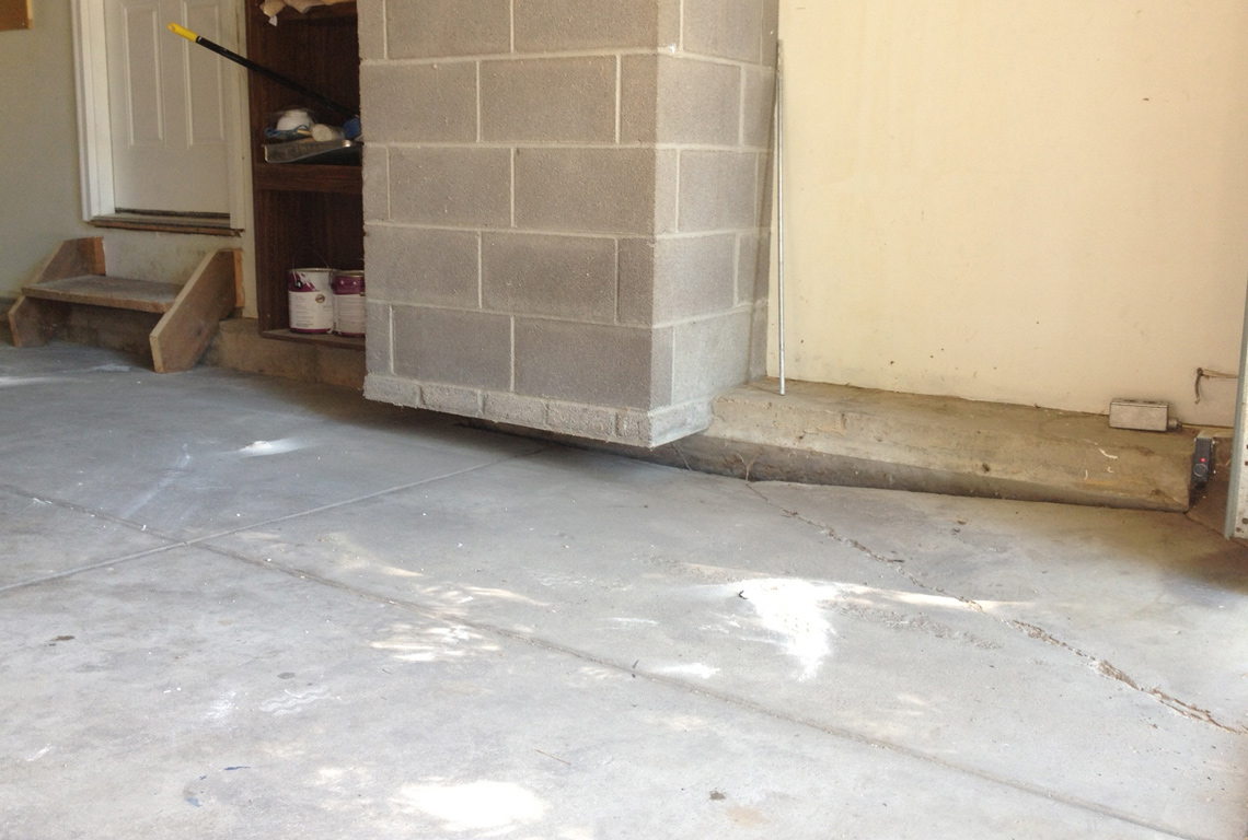 Garage floor in need of concrete lifting