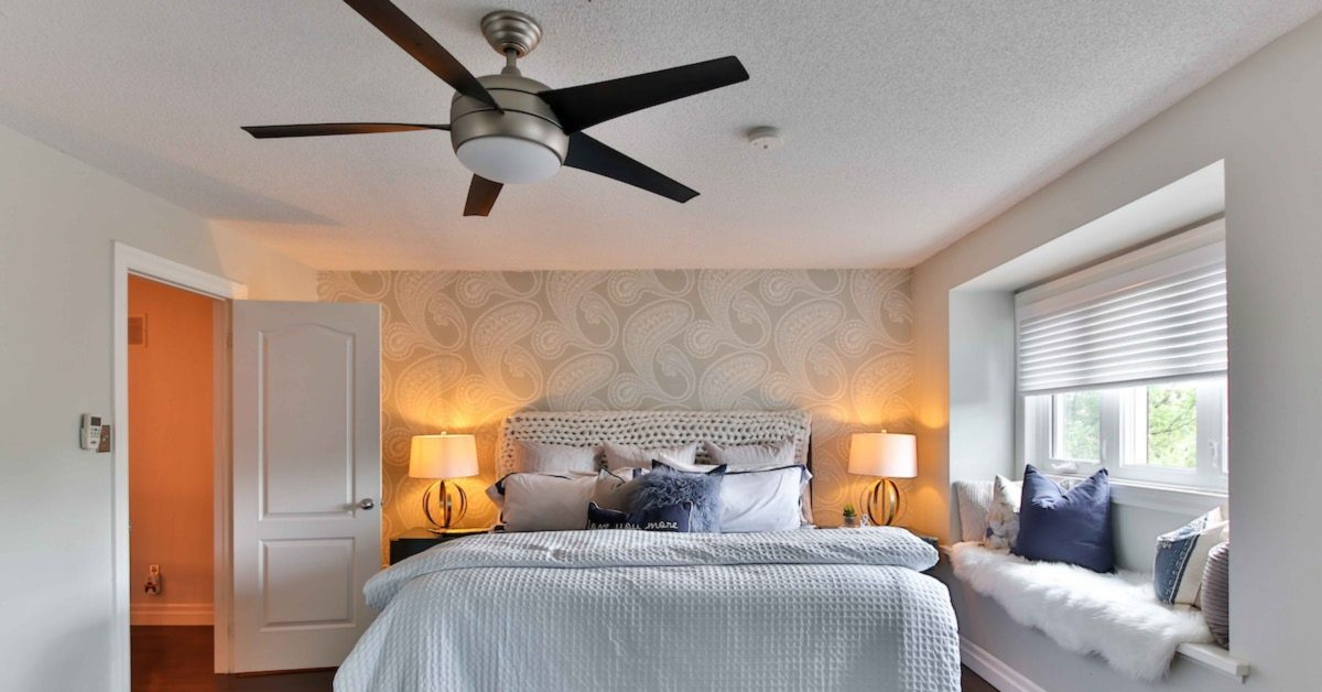 beautiful bedroom with a ceiling fan