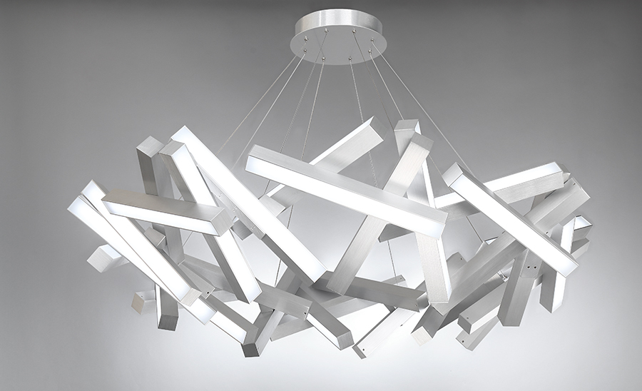 Modern light fixture featuring bars of silver with lights on one side suspended as a pendant light