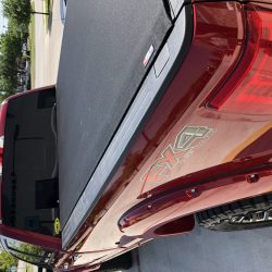 red truck with tonneau cover at LINE-X of Austin