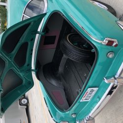 trunk of classic teal car at LINE-X of Austin