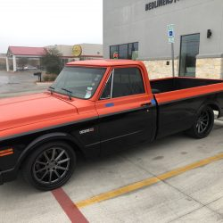 lowered black and red truck at LINE-X of Austin