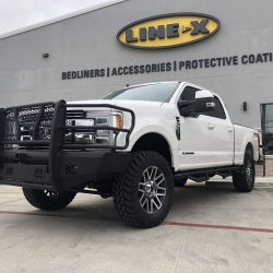 Grille guard on lifted white truck at LINE-X of Austin
