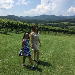 Mani Kukreja, Lifestyle Coach, Walking Through a Vineyard