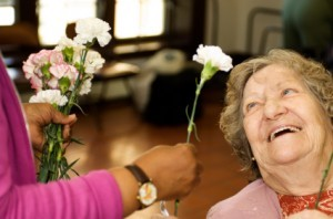elder-woman-get-flower-300x198