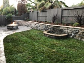 backyard with water feature and fire pit