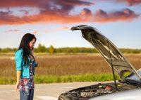 Girl staring at car engine