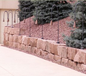Landscaping using a natural stone retaining wall and crushed stone landscape.