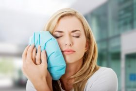 Woman Using Ice Bag on Jaw