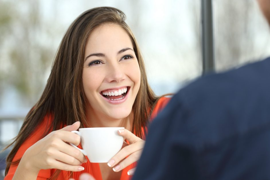Young Woman Smiling Drinking Tea