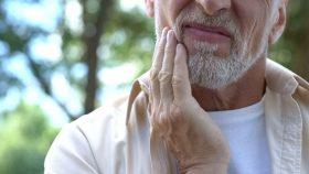 Man Rubbing Sore Jaw
