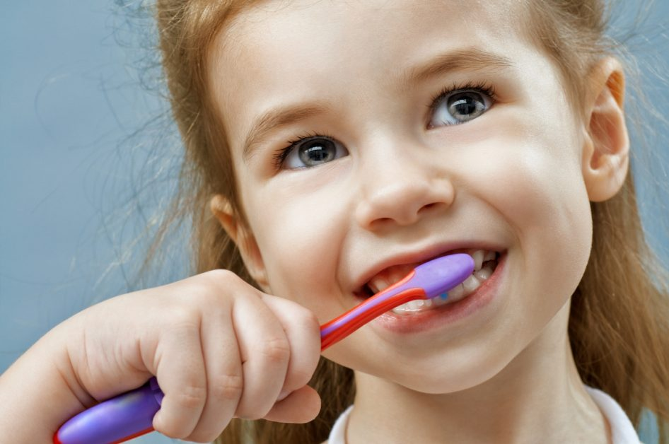 Young Girl Using Children's Toothbrush