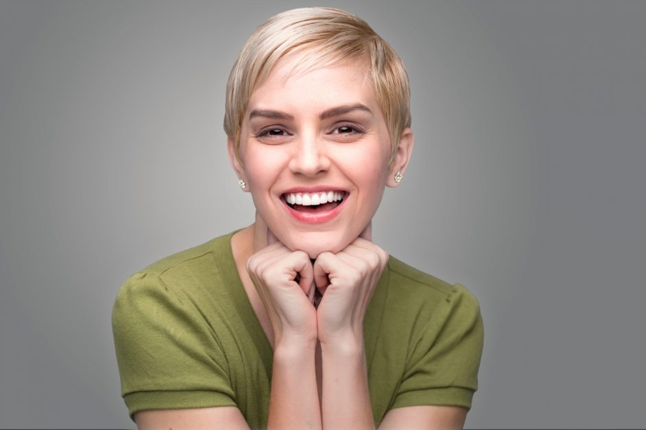 Young Woman Posing and Smiling With White Teeth