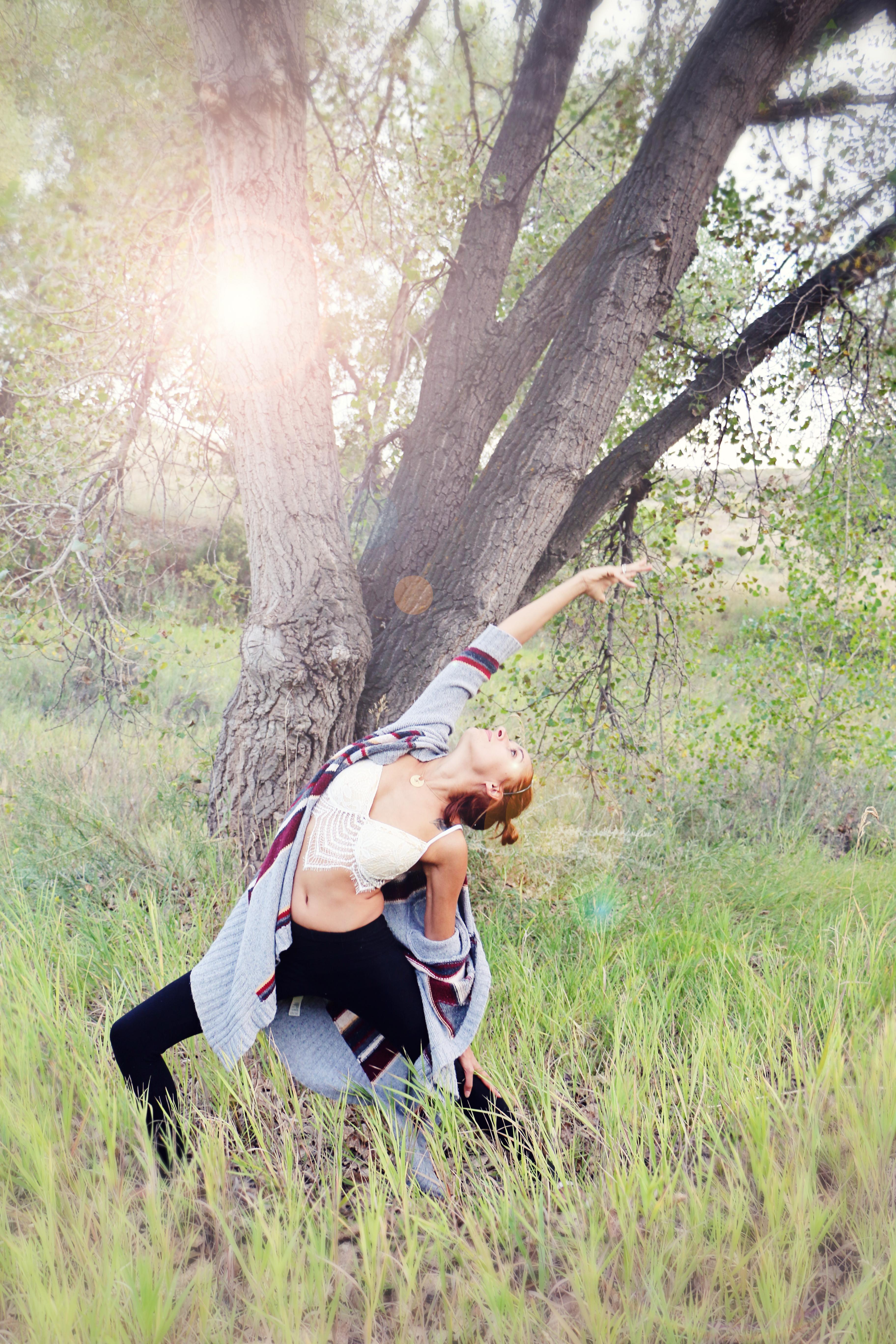 A yoga-posed senior photograph taken by Casey Jagoras, photographer in Loveland.