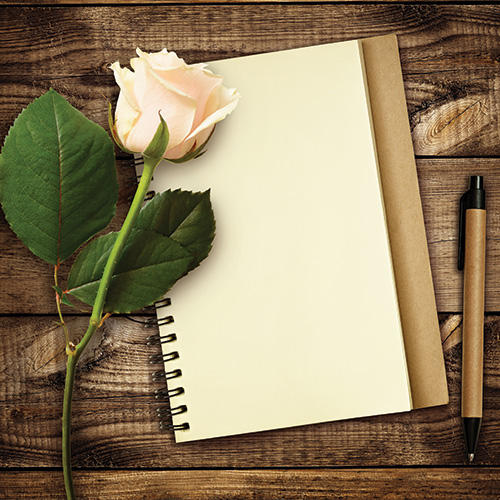 Notebook and rose - a poetry image