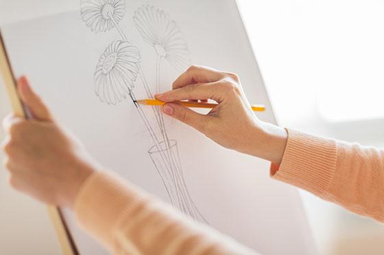 Hands sketching artwork