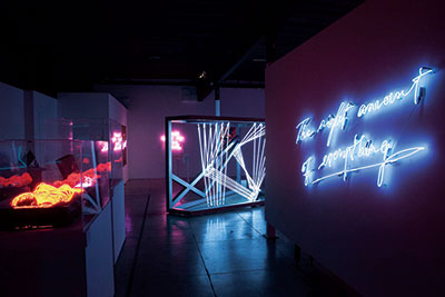 She Bends exhibit gallery shot of neon art