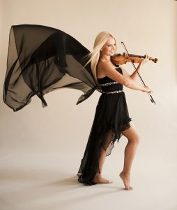 Mairead Nesbitt, an Irish violinist, playing her violin.