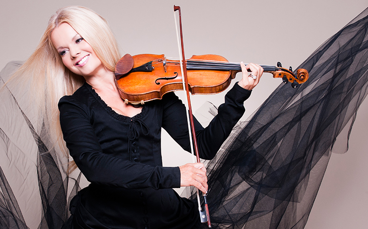 Mairead Nesbitt, Celtic violinist, plays her violin.