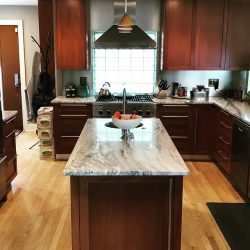 Ideal kitchen with an island from the general contractors at Masterworks Contracting in Metro Detroit.