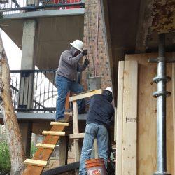 Build concrete jacket forms, install rebar cages, pour BASF MasterEmaco S-440