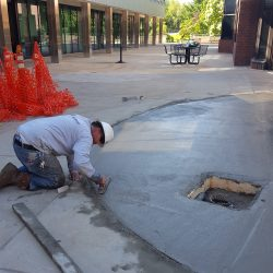 repair and patch concrete, pressure wash, installation of high performance overlay, installation of urethane sealant