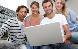 Man And his Friends Looking at his Laptop