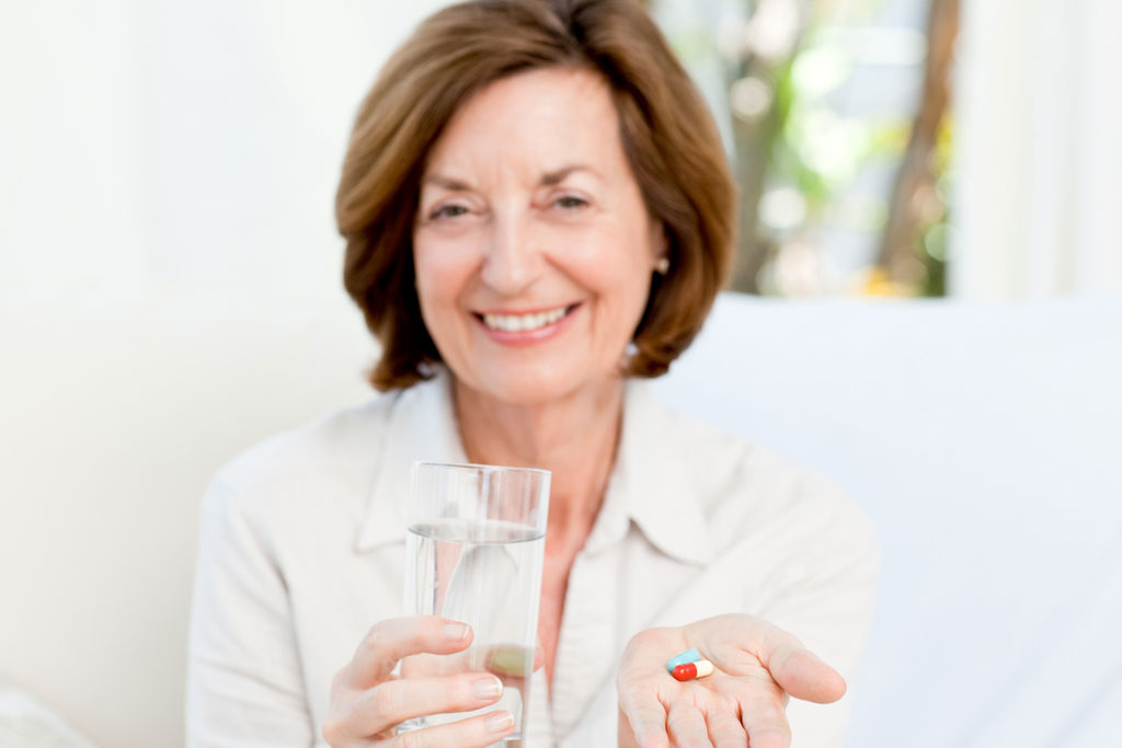 cute-mature-woman-with-pills