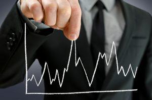 Male hand pulling line chart upwards