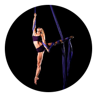 Circle image of dancer twirling in ribbon
