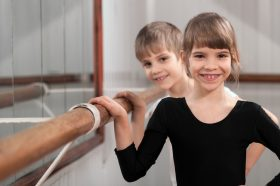 Image of two smiling children at a Ballet Corner