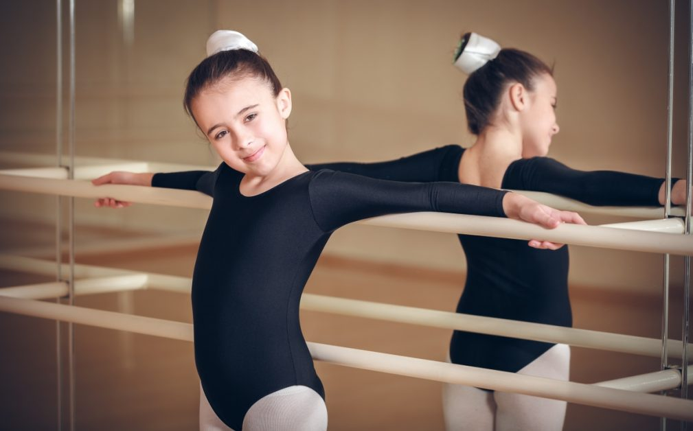 Image of girl posing at a ballet handbar