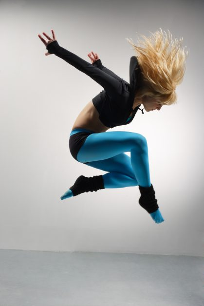 Image of woman contemporary dancing in blue and black outfit