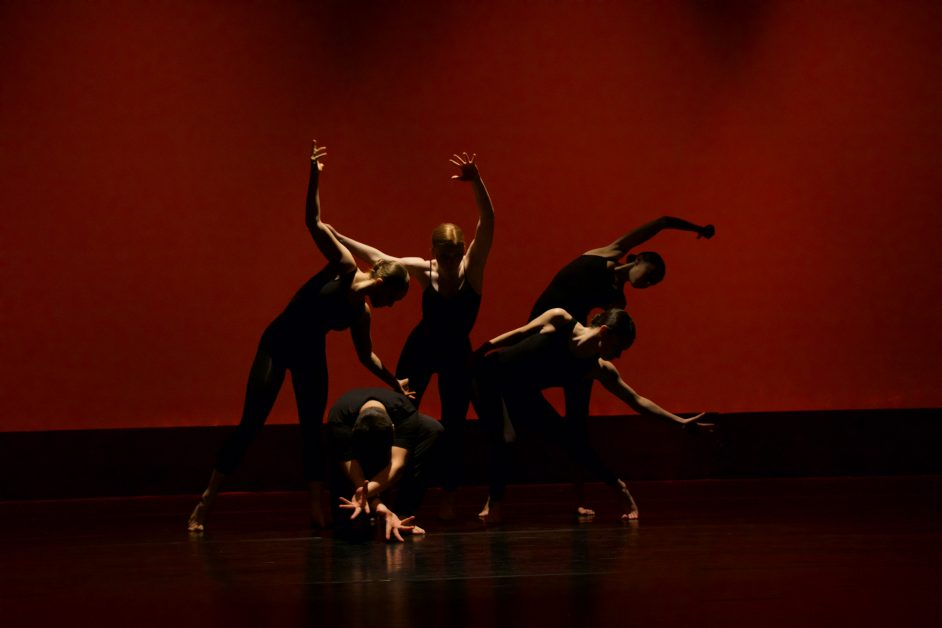 Image of a dance company on stage.
