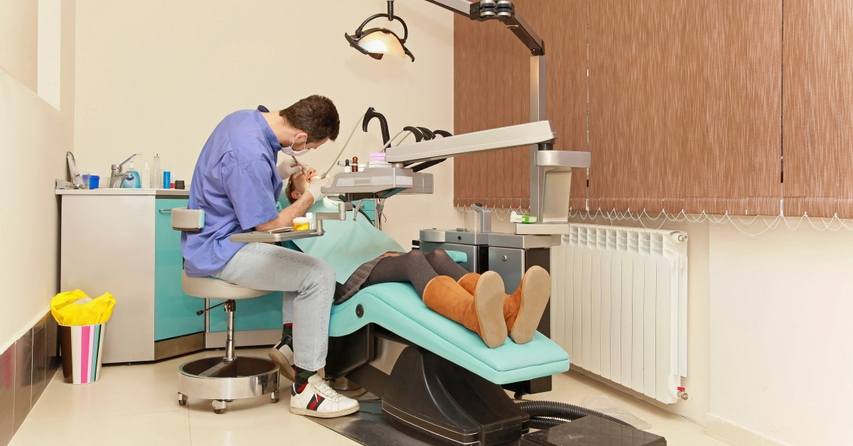 dentist operating on person in a dental chair