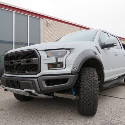 Image showing the front of a white Ford pickup truck.