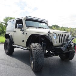 Picture of a light grey Jeep with customized parts.