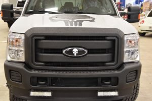 Closeup view of truck front with Punisher theme in LINE-X finish