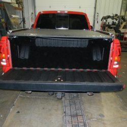 Rear view of red truck outfited with LINE-X bed liner