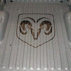 Close shot of Dodge symbol in spray-on bed liner