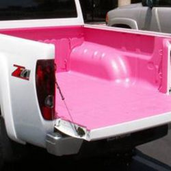 White truck with custom pink bed liner from LINE-X of Indianapolis