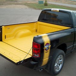 Overhead shot of yellow spray-in bed liner on black Dodge truck