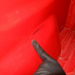 Closeup view of red truck bed before LINE-X of Indianapolis coatings