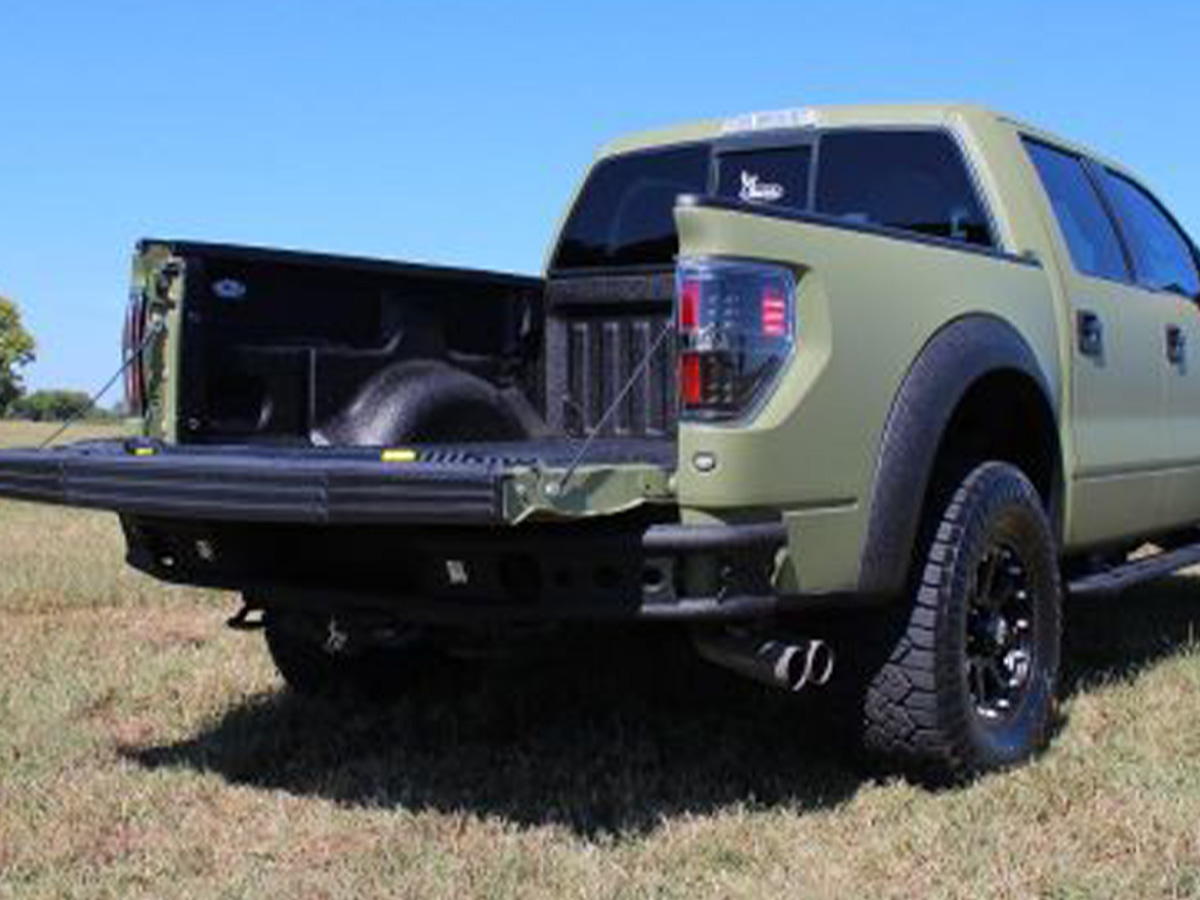 Truck with tailgate down and bed lining.
