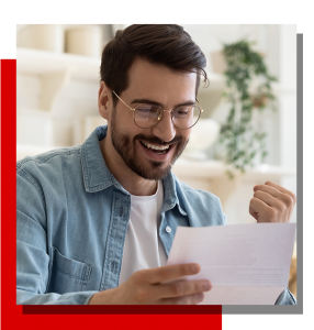 Image of a man excited going over some paperwork.